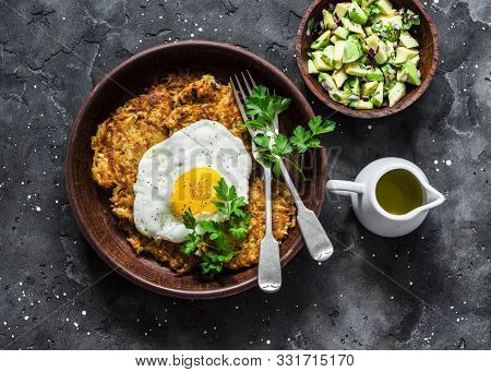 Pumpkin Rostis With Fried Egg And Avocado Salsa On Dark Background, Top View. Delicious Breakfast, S