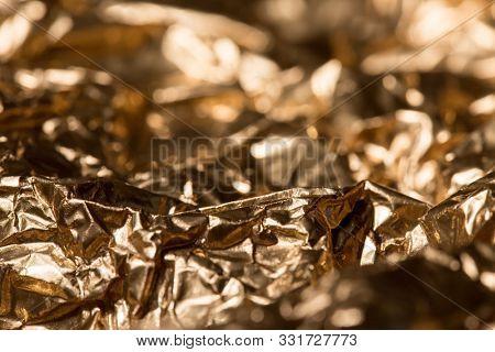 Golden grunge texture. Vintage abstract golden background for your design. Luxury golden background. Shiny golden texture.