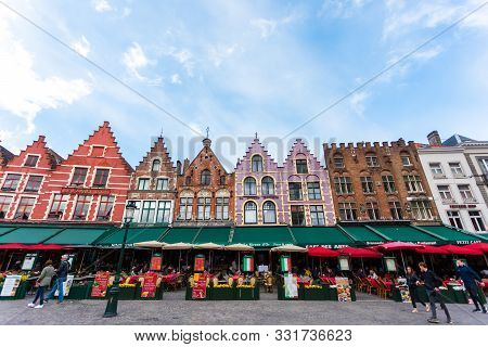 Bruges, Belgium - May 04, 2019: View Of The Colorful Houses In Traditional Flemish Style On Grote Ma