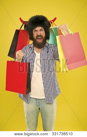 Shopping Champion. Happy Hipster In Bull Horns Hat Holding Paperbags After Successful Shopping. Bear
