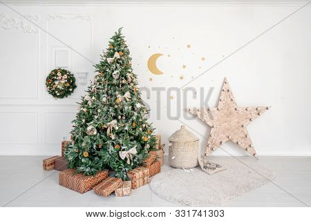 Childrens Room With Decorated Christmas Tree And Presents. Christmas Morning. White Room With Stucco