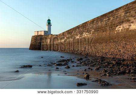 Green Lighthouse Of The Little Jetty Of Les Sables D Olonne At Low Tide In The Early Morning (vendee