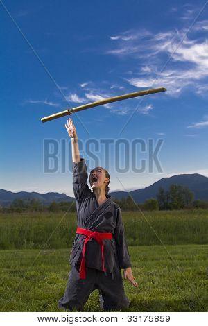 Ninja girl throwing katana in air
