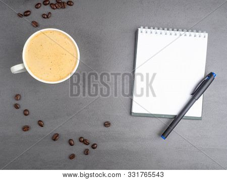 Morning Workplace As Cup Of Coffee, Coffee Beans And Notepad For Notes. Minimalism Concept