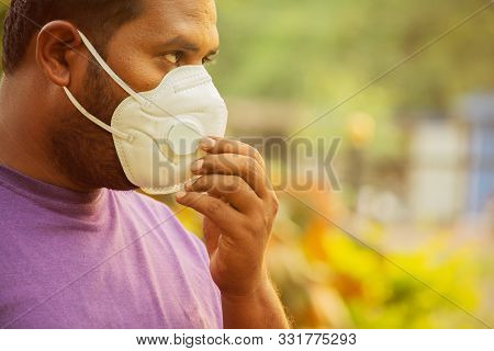 Asian Man Wearing The Face Mask Due To Air Pollution - Young Adult On Park With Pollution Mask - Per