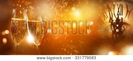 New Years Eve Champagne With Clock And Fireworks In The Background For New Year Greetings