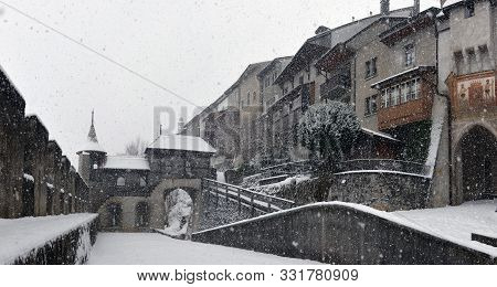 Gruyeres, Switzerland, Yanuary 05 2017: The Buildings Located Along The Main Square Of This Medieval