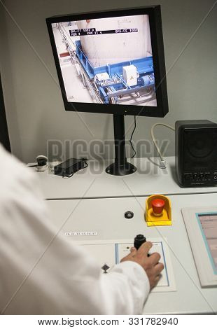 Chernobyl, Ukraine -  October 16, 2015: Engineer Monitoring Nuclear Reprocessing In A Control Room A