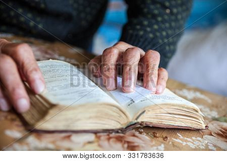Old Woman Hands On The Open Prayer Book (christian Prayer Book In Ukrainian). Reading The Book. Pray