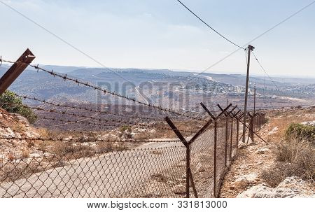 Rosh Haayin, Israel, October 31, 2019 : Barbed Wire Fence Enclosing The Village Peduel In The Samari