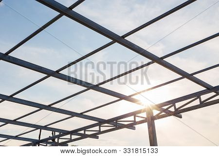 Structure Of Steel Used To Build Accommodation. Steel Structure Of The House On Sky Background.