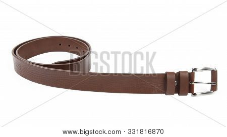 New Light Brown Leather Belt With A Nickel Buckle. Without Shadows. Isolated On White Background