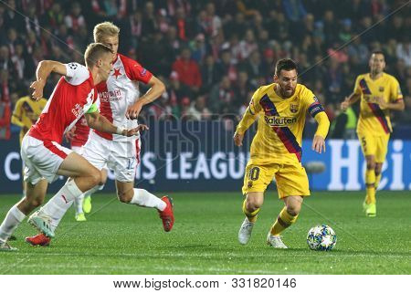 Prague, Czechia - October 23, 2019: Lionel Messi Of Barcelona (r) Controls A Ball During The Uefa Ch