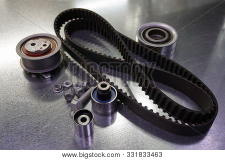 Repair kit for replacing the timing belt. The kit consists of a timing belt, a tension roller, a byp