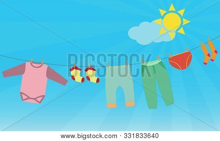 Child Washed Clothes On The Clothesline Outdoors On A Sunny Day