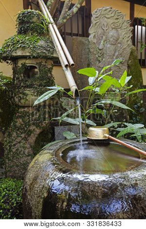 Traditional Japanese Bamboo Purification Fountain For Purification At Entrance Of The Japanese Templ