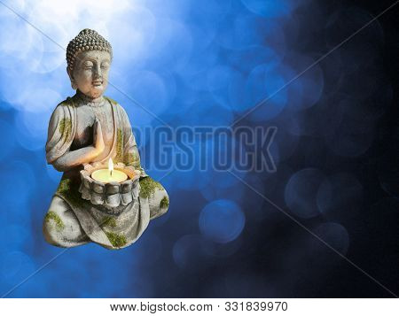 Rocked Statue Of Budha Isolated In Bokeh Background