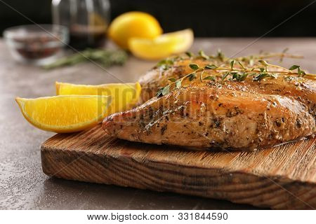 Baked Lemon Chicken With Thyme Served On Grey Marble Table
