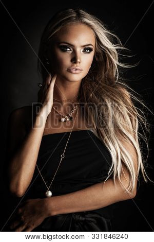 Young lady with luxury accessories in beautiful modern interior