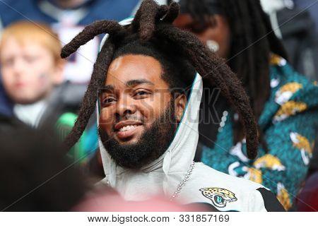 LONDON, ENGLAND - NOVEMBER 03 2019: a Jaguars fan during the NFL game between Houston Texans and Jacksonville Jaguars at Wembley Stadium