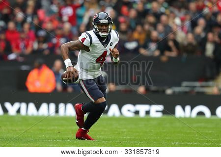 LONDON, ENGLAND - NOVEMBER 03 2019: Houston Texan's quarterback, Deshaun Watson (4) runs with the ball during the NFL game between Houston Texans and Jacksonville Jaguars at Wembley Stadium