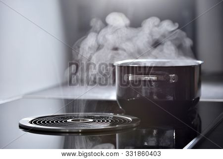 Modern Electric Induction Cooker With Built-in Ventilation And Extractor Hood Which Draws Steam From