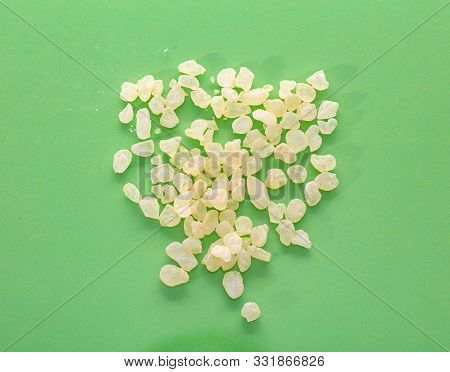 Chios Mastic Tears Pile On Green Background