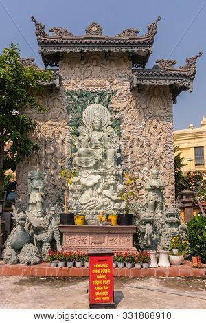 Da Nang, Vietnam - March 10, 2019: Chua An Long Chinese Buddhist Temple. Front Shot: Greenish Stone