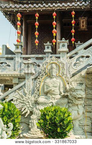 Da Nang, Vietnam - March 10, 2019: Chua An Long Chinese Buddhist Temple. Gray Stone Bodhisattva Fres