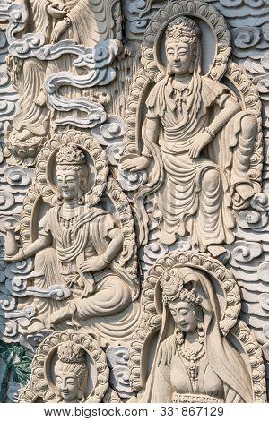 Da Nang, Vietnam - March 10, 2019: Chua An Long Chinese Buddhist Temple. Gray Stone Happy  Multiple