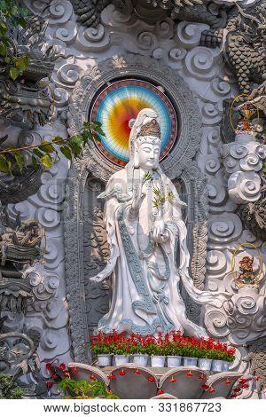 Da Nang, Vietnam - March 10, 2019: Chua An Long Chinese Buddhist Temple. Closeup Of Gray Stone Guan