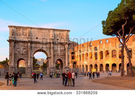 Rome, Italy - October, 2019: The Arch Of Constantine And The Colosseum During Golden Hour Sunset Tim