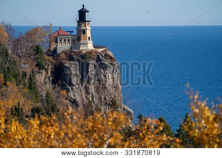 Natural Framing Of Split Rock Lighthouse On The North Shore Of Minnesota, Framed By Fall Leaves