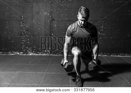 Dumbbell Legs Training, Young Strong Fit Muscular Sweaty Man With Big Muscles Strength Cross Workout