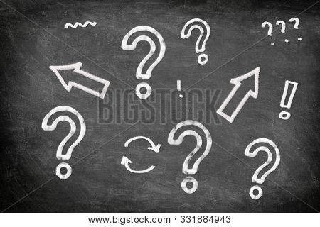 Blackboard chalkboard with hand drawn question mark and exclamation marks arrows drawings illustration for creativity, confusion, choice, startup business ideas, problem solving concept on black board