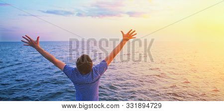Happy Prayer Man With Open Outstretched Arms. Sunset Sea And Clouds In Light Blue Morning Sky. Chris