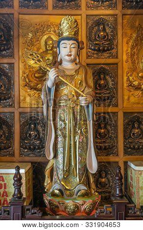 Da Nang, Vietnam - March 10, 2019: Chua An Long Chinese Buddhist Temple. Tall Colorfully Painted Por