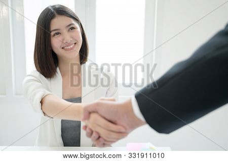 Beautiful Young Asian Business Woman Smile And Shaking Hands Deal Accept Partnership Business In The