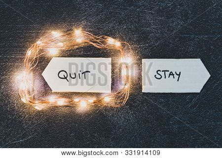 Stay Vs Quit Text On Signs Pointing At Opposite Directions With Led Lights Emphasizing The Quit Opti