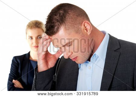 Worried businessman with headache standing on white background. Stressed businesspeople.