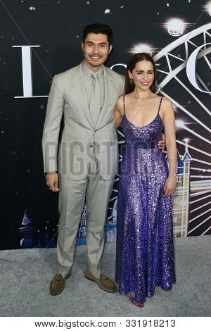 NEW YORK - OCT 29: Henry Golding (L) and Emilia Clarke attend the Universal Pictures premiere of 'Last Christmas' at AMC Lincoln Square on on October 29, 2019 in New York City.