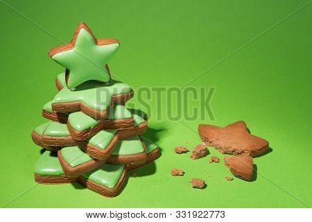 Gingerbread Christmas Tree With Green Icing, On A Green Background, Near A Broken Gingerbread, Minim