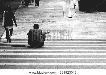 Homeless Man Asking For Help And Money/ Poor Man At The Street/ Homeless Beggar Man Sitting Outdoors