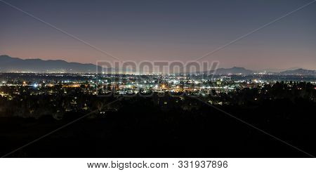 Panoramic predawn San Fernando Valley view from the Santa Susana Mountains in Los Angeles, California.