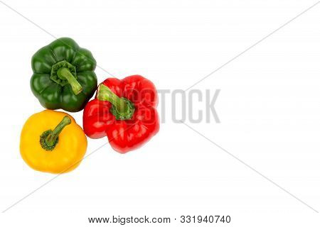 Green, Red And Yellow Bell Peppers On Isolated Backgrounds