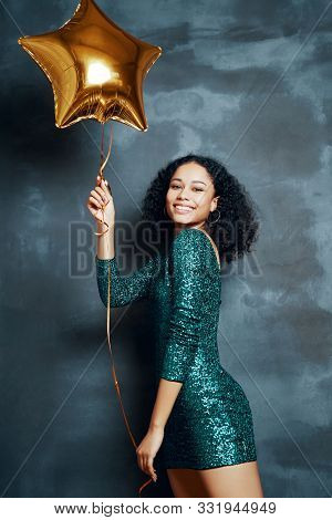 Beautiful Young African Woman Having Fun And Holding Golden Balloon. Party Time, Celebration Concept