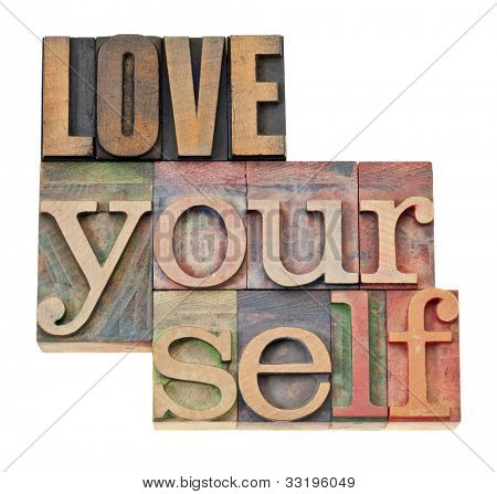 love yourself - self esteem concept - isolated text in vintage letterpress wood type