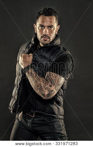 Tattooed Man In Trendy Clothes. Man With Tattoo On Strong Arm Skin. Fashion Macho With Confidence An