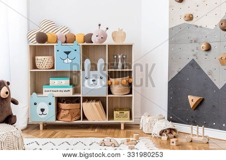 Stylish Scandinavian Child Room With Wooden Cabinet, Toys, Boxes And Plush Teddy. White Walls, Minim