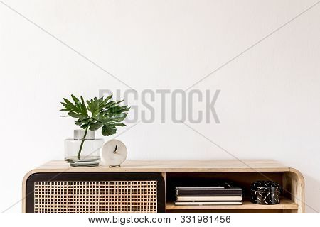 Interior Design Of Living Room At Scandinavian Apartment With Stylish Commode, Tropical Leaf In Vase